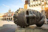 KRAKOW, POLAND - FEB 28, 2014: Igor Mitoraj's sculpture Eros Bendato (Eros Tied) 1999 on main square of the city. This worth about half a million euros bronze sculpture was donated to Krakow for free.
