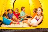 Six pretty kids in a tent
