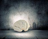 Huge human brain against modern city background