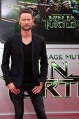 LOS ANGELES - AUG 3:  Brian Tyler at the Teenage Mutant Ninja Turtles Premiere at the Village Theate