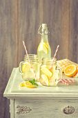 Homemade lemonade drinks with straws - vintage filter effect added