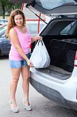Caucasian Woman With Shopping Bag Loading Her Suv