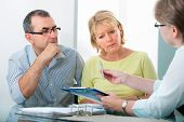 stock photo of family planning  - Mature couple getting financial advice from consultant at home