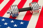 Dumbbells Over Us Flag As Symbol Of Healthy Nation
