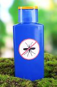 Bottle with mosquito repellent cream on nature background