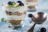 foto of yogurt  - Fresh summer snack blueberries yogurt and muesli - JPG