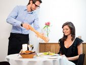 picture of waiter  - Beautiful young lady and waiter in restaurant  - JPG