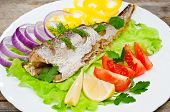pic of hake  - fish hake baked with vegetables on a plate