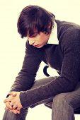Depressed young man close up