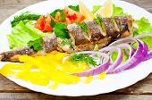 foto of hake  - fish hake baked with vegetables on a plate - JPG