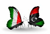 Two Butterflies With Flags On Wings As Symbol Of Relations Italy And Libya