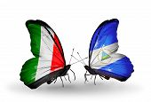 Two Butterflies With Flags On Wings As Symbol Of Relations Italy And Nicaragua