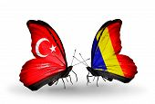 stock photo of chad  - Two butterflies with flags on wings as symbol of relations Turkey and Chad Romania - JPG