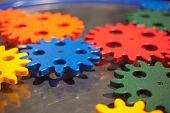 stock photo of cogwheel  - plastic cogwheel working together - JPG