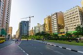 DUBAI - OCT 16: Dubai streets on October 16, 2014. Dubai is the most populous city and emirate in the UAE, and the second largest emirate by territorial size after the capital, Abu Dhabi