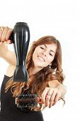 Pretty Woman Using Hairdryer And Hairbrush At Work