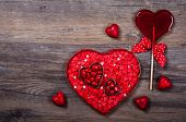 Heart shaped box with Valentine's Day candies on the vintage wooden background