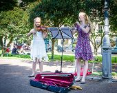 Girls entertain visitors in Esplanade Park in Helsinki