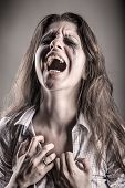 stock photo of cry  - Crying woman on a dark background - JPG