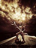 Metal Alien warrior on earth