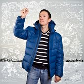 Asian man in blue down-padded coat, with winter fun sketch background