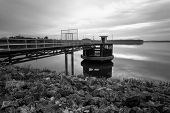 The Long Bridge Toward To Pump House At Reservoir In Black And White,thailand
