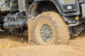 pic of four-wheel drive  - 4x4 vehicle driving offroad in muddy terrain in the wilderness - JPG