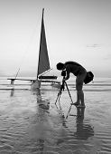 Photographer Is Taking A Photo Of A Sailboat In Black And White