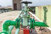 foto of groundwater  - Valve mounted on roof top industry building  - JPG