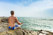 Man Meditating In Front Of Sea