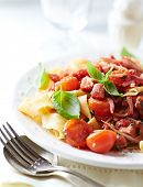 Pappardelle pasta with cherry tomatoes and pancetta