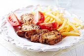 Roast chicken breast with french fries