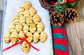 stock photo of crescent-shaped  - Cinnamon crescents shaped and decorated like Christmas tree - JPG