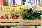 foto of wooden crate  - Wooden crates full with fresh vegetables sold on green market - JPG