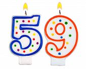 foto of fifties  - Birthday candles number fifty nine isolated on white background - JPG