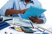 pic of accounting  - Black man working in office with tablet computer - JPG
