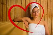 Calm woman relaxing in a sauna against heart