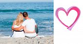 image of couple sitting beach  - Affectionate couple sitting on the sand at the beach against heart - JPG