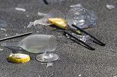 Broken Cocktail Cups After A Party. Asphalt Pavement; Macro; A Shallow Focus