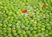 stock photo of boiling water  - Fresh Green peas floating in boiling water - JPG