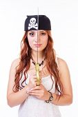 foto of pirate sword  - Dangerous pirate woman with copper hair holding a sword in front of her face  - JPG