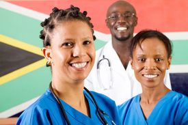 stock photo of health-care  - group of south african medical workers portrait in front of south african flag - JPG