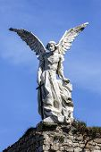 image of guardian  - Sculpture of a Guardian angel with a sword in the cemetery of Comillas - JPG