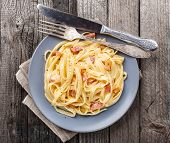 picture of carbonara  - Pasta carbonara on a gray rustic background - JPG