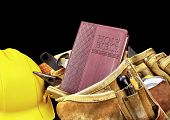 stock photo of bible verses  - Bible in Construction Belt and Tools on Black Background - JPG