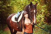 stock photo of horse-breeding  - girl with horse girl with horse girl with horse - JPG