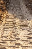pic of wheel loader  - wheel track and foot print on clay road - JPG