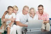 image of scandinavian  - Scandinavian family happy to be together to operate with computer - JPG