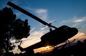 stock photo of helicopter  - silhouette of a helicopter with sunset background - JPG