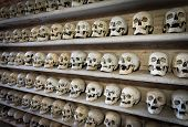 stock photo of catacombs  - view of human skulls inside a Christian catacomb - JPG